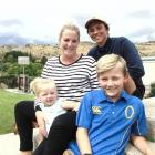 Child cancer ambassador Caleb Darling (10, front) with his sister Emmie (2), mother Genna and...
