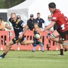 Highlanders centre Matt Faddes runs in for his second try, watched by Crusaders lock Scott...
