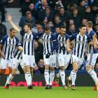 West Bromwich Albion players Jonny Evans (with raised arm) and Gareth Barry (second from right)...