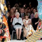 Queen Elizabeth II sits next to Vogue Editor-in-Chief Anna Wintour as they view Richard Quinn's...