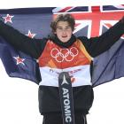 Wanaka winter athlete Nico Porteous poses with the New Zealand flag after taking bronze in the...