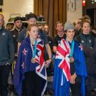 Zoi Sadowski-Synnott (L) and Nico Porteous are welcomed home at Auckland International Airport...