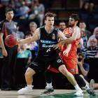 Retiring Breakers guard Kirk Penney posts-up Jarrad Weeks of the Cairns Taipans during an NBL...