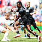 Joe Ravouvou of New Zealand makes a break against England during the 2018 New Zealand Sevens....