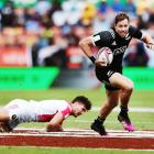 Tim Mikkelson of New Zealand beats a tackle against France during the 2018 New Zealand Sevens....