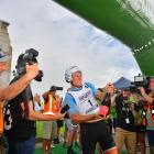 Sam Clarke  cracks open the bubbly at the finish line after winning the Longest Day race of the...