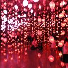 Visitors walk through ''pixels'' in Pipilotti Rist's exhibition Sip my Ocean at the Museum of...