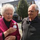 Margaret van Zyl and Ian Norris, both of Mosgiel, inspect a kitchen timer after speaking in a...
