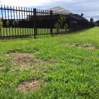 Dirt patches remain were exercise equipment has been removed from Highland Park reserve in...