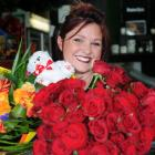 Dunedin florist Donna Hewer with red roses and a colourful bouquet for Valentine's Day. Photo:...