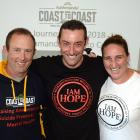 The Key to Life Trust ambassador Scott Weatherall (centre) embraces two of his Coast to Coast...