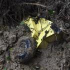 Greg Davis' wood chipper was washed down the hill from Balaclava and is now deep in the mud in...