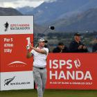 Tim Wilkinson, one of the leading New Zealanders, watches the flight of the ball after teeing off...