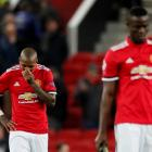 Dejected Manchester United players Ashley Young (L) and Eric Bailly after the match Photo: Reuters