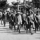 North Otago's quota to the 39th Reinforcements: men en-route to the Oamaru railway station. -...
