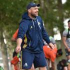 Highlanders scrum coach Clarke Dermody gets ready for training at Logan Park yesterday. Photo:...