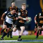 Damian McKenzie makes a break for the Chiefs against the Brumbies. Photo: Getty Images