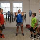 Graeme Evans trains for his first weightlifting competition as sons (from left) Toby, Luke  and...