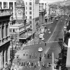 At noon on August 11, 1959, traffic lights were stopped in the Exchange area of Dunedin in...