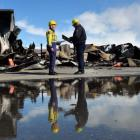 Fire risk management officers Catherine Trevathan and Stuart Ide confer at the scene of the...