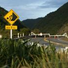 A sign warns of slip danger in front of a road closure barrier at the Manawatu Gorge. Photo:...