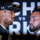 Anthony Joshua (left) and Joseph Parker square off during a press conference at the Dorchester...