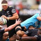 The Sharks' Stephan Lewies outjumps Ned Hanigan of the Waratahs to take the ball in a lineout....