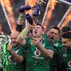 Ireland's Rory Best, Peter O'Mahony and team mates celebrate with the Six Nations trophy during...