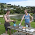 German honeymooners Hendrik (left) and Bastion Schons prepare lunch next to Macandrew Bay beach,...