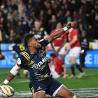 Waisake Naholo celebrates his try during The Highlanders against the 2017 British and Irish Lions...