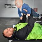 Club rugby veteran Peter Mirrielees plays with son Arlo-Manaaki (7 months) at Let's Go Fitness in...