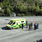 A rescue helicopter lands on the beach by Edith Cavell Bridge, Arthurs Point, about noon today,...