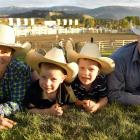 Alyce, Hunter, Clayton and Anthony Perkins enjoy the national rodeo finals in Wanaka at the...