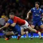 France's Gael Fickou in action with Wales' Gareth Davies. Photo: Action Images via Reuters/Paul...