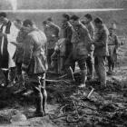 Maori soldiers on the Western Front singing at the graveside of their beloved leader, Lieut-Col G...