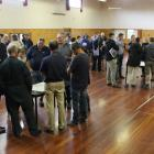 Farmers group together to discuss tactics to prevent the spread of Mycoplasma bovis when stock...