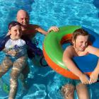 Steve Earp and his children, Iris and George, of Dunedin, enjoy the St Clair Hot Salt Water Pool...