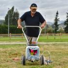 Wanaka A&P Show volunteer Peter Williams, of Oamaru, marks out trade exhibitor sites at...