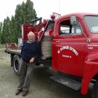 George Wallis stands beside his restored 1950 International truck which was driven to the Wanaka...