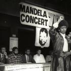 Winnie Mandela raises her fist in a black power salute after announcing that a massive pop...