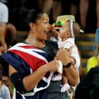 Dame Valerie Adams enjoys a moment with daughter Kimoana after the Women's Shot Put final. Photo:...