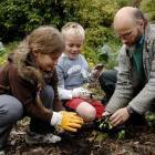 Dunedin Environment Centre trustee Joseph Dougherty instructs Macandrew Bay School pupils Katie...
