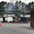 Firefighters inspect the aftermath of a bus fire in Cromwell in January. PHOTO: SUPPLIED