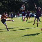 Matt Griffiths (left) of the Clyde-Earnscleugh premier team faces off against Ben Carr (centre)...