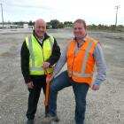 Clutha District Mayor Bryan Cadogan (left) and SouthRoads Ltd construction division manager...