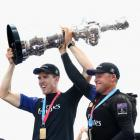 Glenn Ashby (right) lifts the America's Cup with Peter Burling. Photo: Getty Images