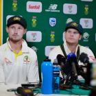 Cameron Bancroft (left) and Steve Smith at the press conference immediately after the ball...