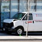 A van seized by police lies damaged after an incident where a van struck multiple people at a...