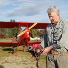 Before taking off in a Tiger Moth for a flyover of an Anzac Day service in Lowburn, Daniel...