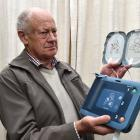 Balmacewen Lions Club president Brian Tegg, displays one of the automated external defibrillators...
